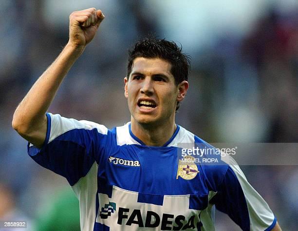 Deportivo Coruna's forward Albert Luque celebrates after scoring against Racing Santander during their Spanish league match at Riazor stadium in...