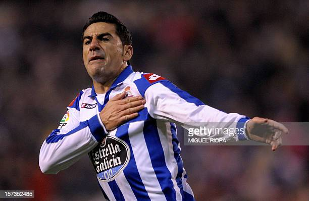 Deportivo Coruna's forward Riki celebrates after scoring his second goal during the Spanish league football match Deportivo vs Betis at Riazor's...