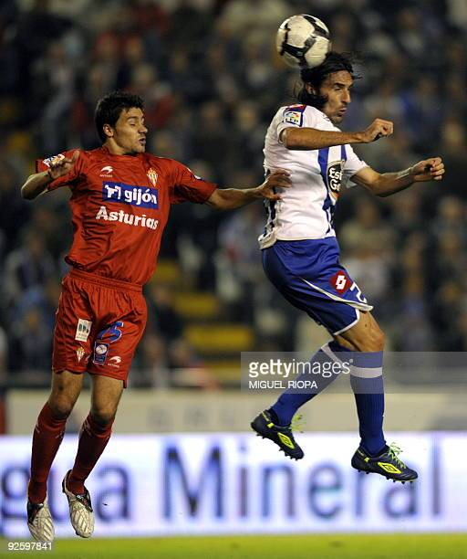 Deportivo Coruna's forward Riki vies with Sporting Gijon's defender Roberto Canella during their Spanish first league football match at the Riazor...