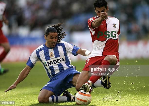 Deportivo Coruna's Juan Manuel Delgado vies with Getafe's Ivan Sanchez Riki during their Spanish first league football match at Riazor Stadium in...