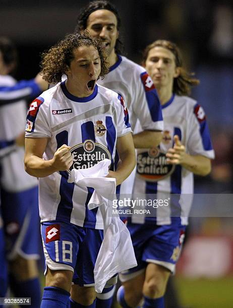 Deportivo Coruna's Mexican midfielder Andres Guardado celebrates with teammates after scoring against Atletico Madrid in the last minute of their...