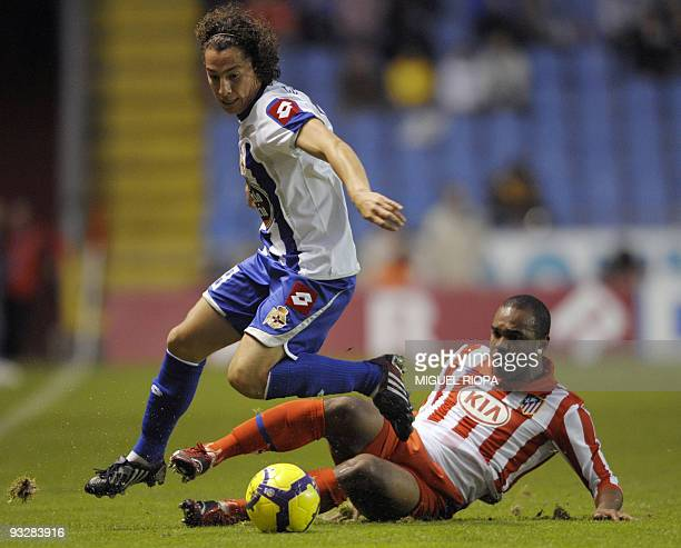 Deportivo Coruna's Mexican midfielder Andres Guardado vies with Atletico Madrid's French forward Sinama Pongolle during their Spanish first league...