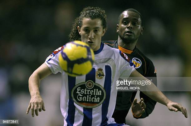 Deportivo Coruna's Mexican midfielder Andres Guardado vies with Valencia's Portuguese defender Miguel Monteiro during their Spanish first league...