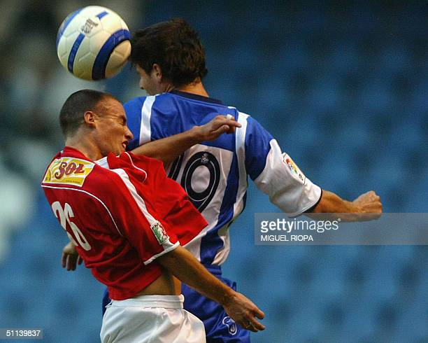 Deportivo Coruna's player Albert Luque heads for the ball with Veracruz's Lucas Ayala, during the friendly football match at Riazor stadium, in...