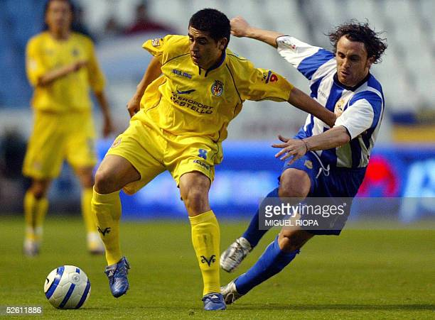 Deportivo Coruna's player Sergio Gonzalez vies for the ball with Villarreal's Argentinian Juan Roman Riquelme , during their Spanish first league...