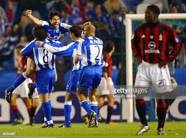Deportivo Coruna's players Sergio Gonzalez, Juan Valeron, Victor Sanchez and Manuel Pablo Garcia celebrate after scoring 3rd goal against AC Milan...