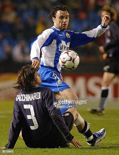 Deportivo de la Coruna's Sergio Gonzalez fights for the ball with Juventus' Alessio Tacchinardi during their Champions League first leg matchday...