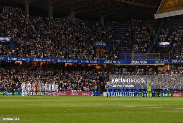 Deportivo La Coruna and Real Madrid players line up to observe a minute's silence in memory of victims of the terrorist attack in Barcelona this week...