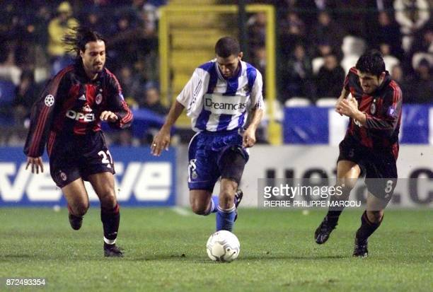 Deportivo La Coruna Brazilian player Djalminha fights for the ball with Milan AC Federico Giunti and Gennaro Gattuso late 06 December 2000 during...