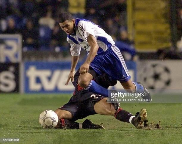 Deportivo La Coruna Brazilian player Djalminha is tackled by Milan AC Massimo Ambrosini late 06 December 2000 during their European Champions league...