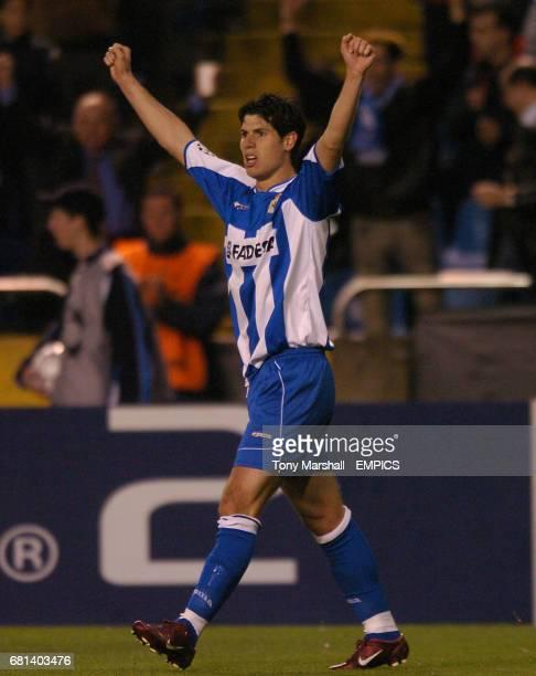 Deportivo La Coruna's Alberto Luque celebrates scoring their third goal against AC Milan