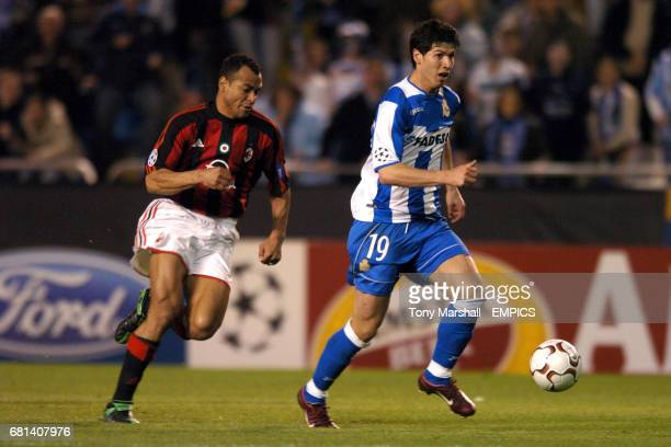 Deportivo La Coruna's Alberto Luque gets past AC Milan's Cafu on his way to scoring the third goal
