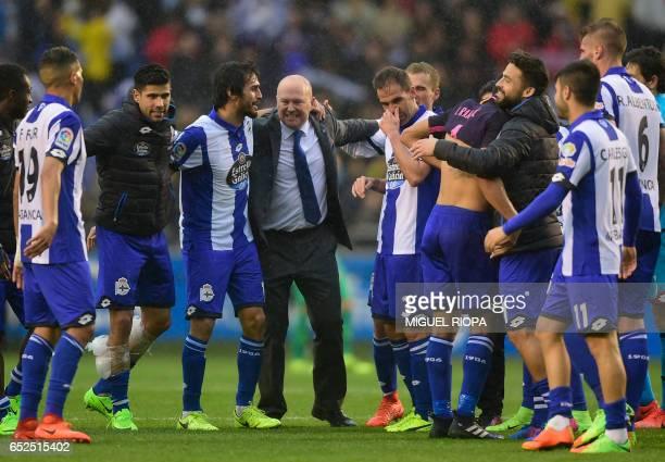 Deportivo La Coruna's coach Pepe Mel celebrates with his players at the end of the Spanish league footbal match RC Deportivo de la Coruna vs FC...