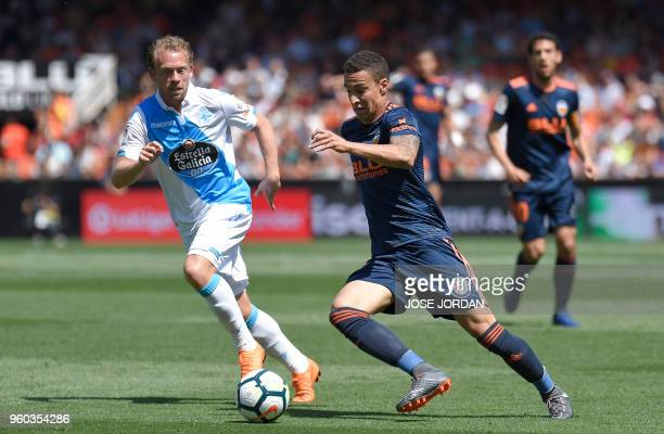 Deportivo La Coruna's Danish midfielder Michael KrohnDehli vies with Valencia's Brazilianborn Spanish forward Rodrigo Moreno during the Spanish...