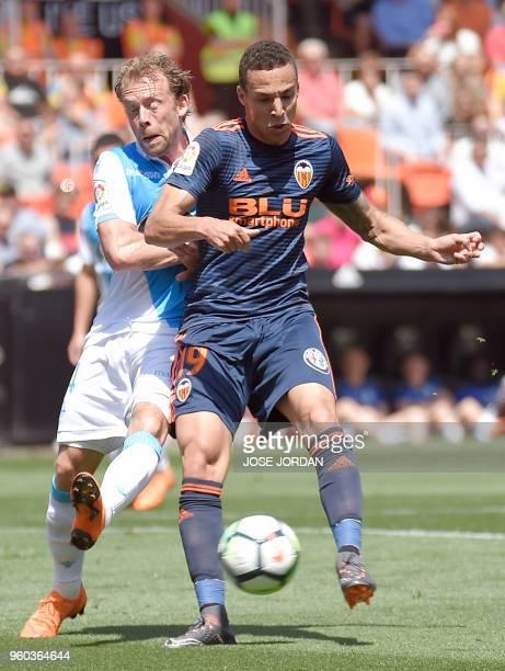 Deportivo La Coruna's Danish midfielder Michael KrohnDehli vies with Valencia's Brazilianborn Spanish forward Rodrigo Moreno during the Spanish...