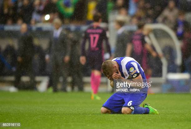 Deportivo La Coruna's defender Raul Albentosa kneels on the field as he celebrates at the end of the Spanish league footbal match RC Deportivo de la...