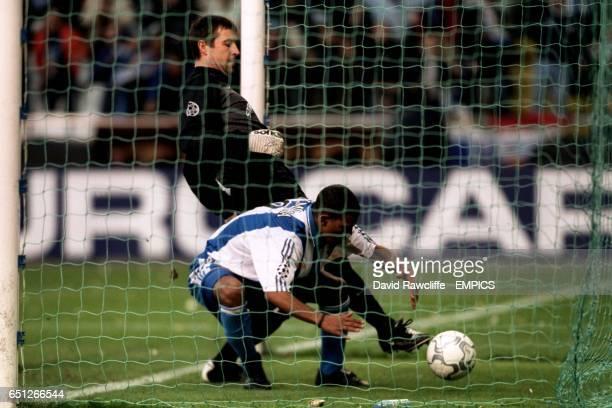 Deportivo La Coruna's Djalminha bends down to retrieve the ball from the net after scoring the opening goal as Leeds United goalkeeper Nigel Martyn...