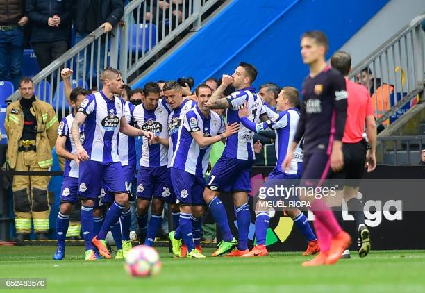 Deportivo La Coruna's forward Joselu celebrates with teammates after scoring during the Spanish league football match RC Deportivo de la Coruna vs FC...