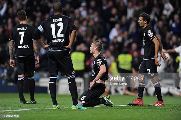 RC Deportivo La Coruna's Jose Luis Joselu Sidnei Rechel da Silva Junior Raul Albentosa and Carlos Borges react after Real Madrid CF scored their...