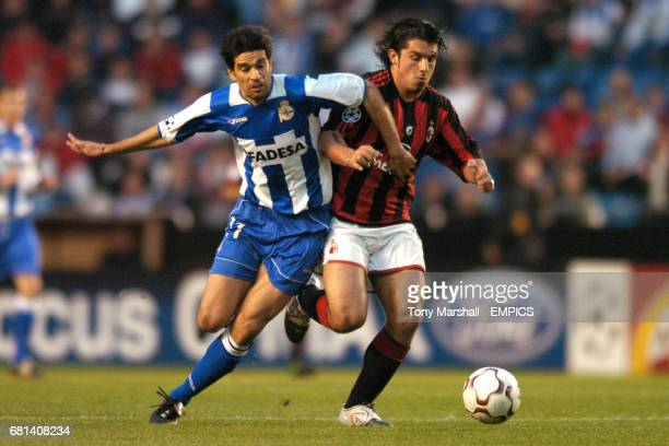 Deportivo La Coruna's Juan Carlos Valeron and AC Milan's Gennaro Gattuso battle for the ball