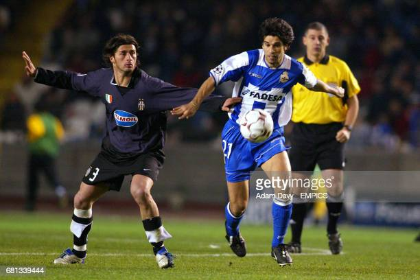 Deportivo La Coruna's Juan Valeron and Juventus' Alessio Taccinardi battle for the ball