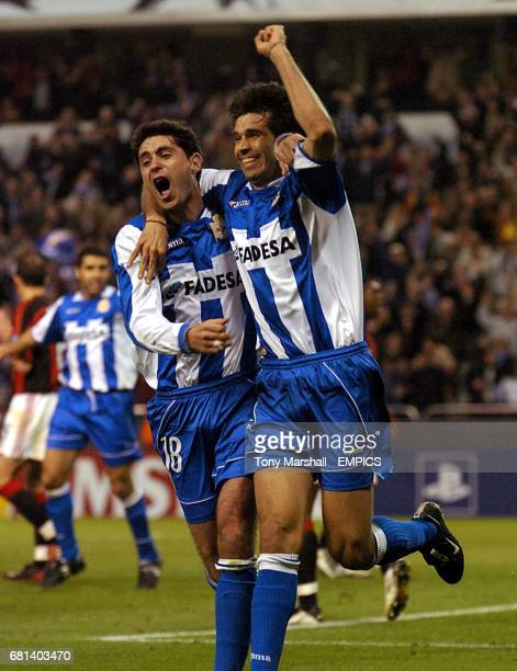 Deportivo La Coruna's Juan Valeron celebrates scoring their second goal against AC Milan with team mate Victor