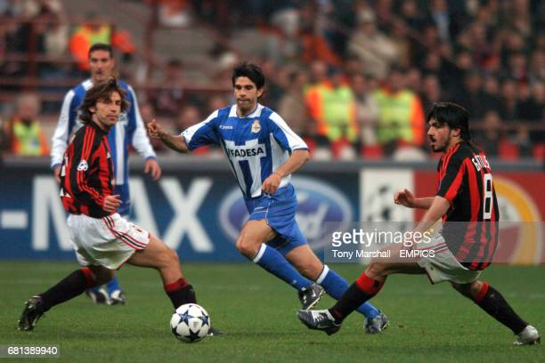 Deportivo La Coruna's Juan Valeron slips the ball past AC Milan's Andrea Pirlo and Gennaro Gattuso