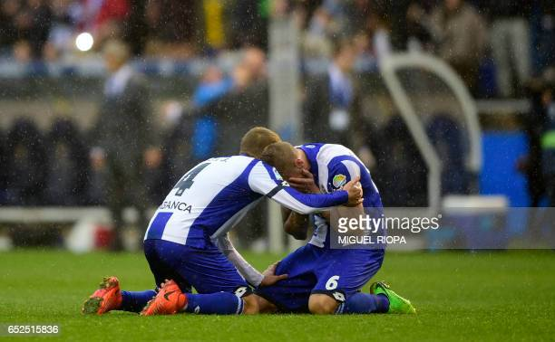 Deportivo La Coruna's midfielder Alex Bergantinos and defender Raul Albentosa celebrate at the end of the Spanish league footbal match RC Deportivo...
