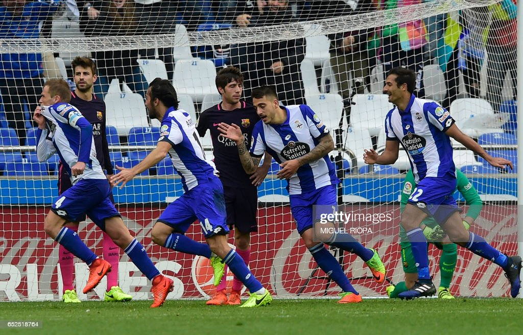 Deportivo La Coruna's midfielder Alex Bergantinos (L) run with teammates as he celebrates a goal during the Spanish league footbal match RC Deportivo de la Coruna vs FC Barcelona at the Municipal de Riazor stadium in La Coruna on March 12, 2017. /