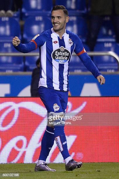 Deportivo La Coruna's midfielder Lucas Perez celebrates after scoring a goal during the Spanish league football match RC Deportivo de la Coruna vs...