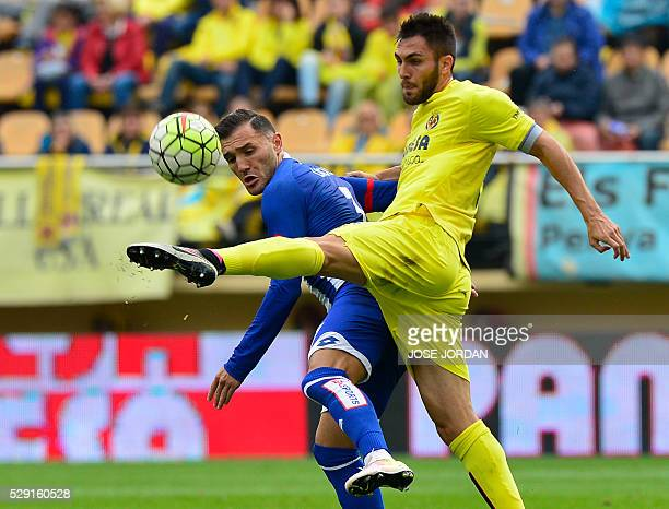 Deportivo La Coruna's midfielder Lucas Perez vies with Villarreal's defender Victor Ruiz during the Spanish League football match Villarreal CF vs RC...