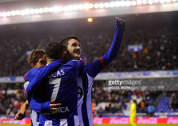 Deportivo La Coruna's midfielder Luis Alberto celebrates with teammates after scoring a goal during the Spanish league football match RC Deportivo de...