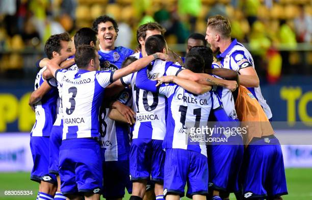 Deportivo La Coruna's players celebrate as they will keep playing in first division next season at the end of the Spanish league football match...