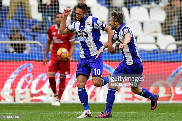 Deportivo La Coruna's Romanian forward Florin Andone celebrates a goal with teammate Portuguese defender Luisinho during the Spanish league football...