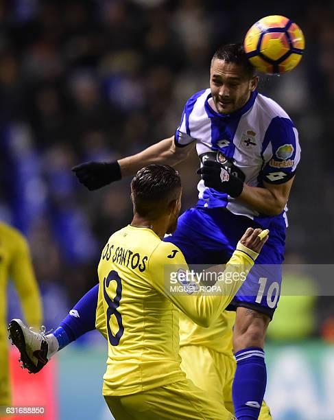 Deportivo La Coruna's Romanian forward Florin Andone jumps for the ball with Villarreal's Mexican forward Jonathan dos Santos during the Spanish...