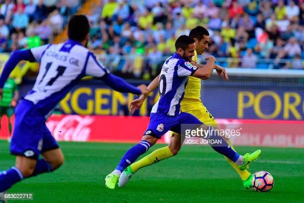 Deportivo La Coruna's Romanian forward Florin Andone vies with Villarreal's midfielder Bruno Soriano during the Spanish league football match...
