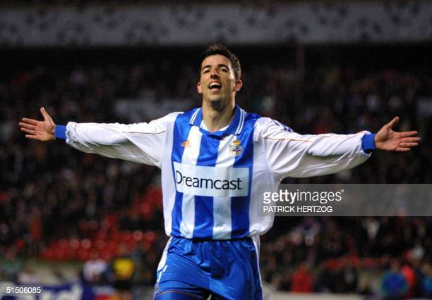 Deportivo La Coruna's Roy Makaay jubilates after he scored the third goal of his team during the PSG/Deportivo La Coruna second round Champions...