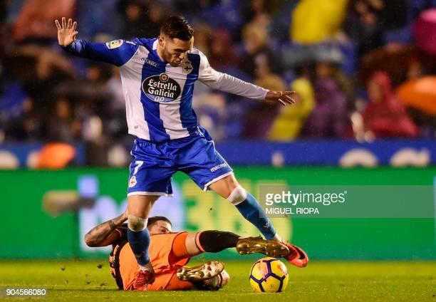 Deportivo La Coruna's Spanish forward Lucas Perez vies with Valencia's Spanish forward Santi Mina during the Spanish league football match between RC...