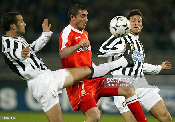 Deportivo La Coruna's Walter Pandiani of Uruguay challenges Juventus defenders Paolo Montero and Ciro Ferrara during their Champions League matchday...