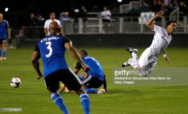 Deportivo Toluca FC's Wilson Tiago goes flying against San Jose Earthquakes' Victor Bernardez in the first half at Buck Shaw Stadium in Santa Clara...