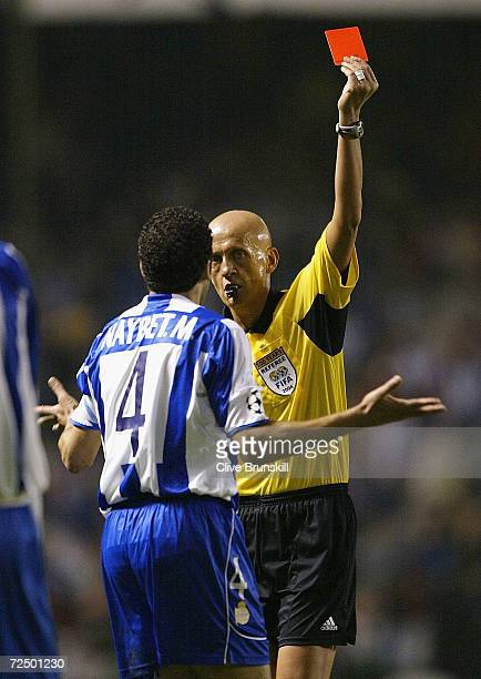 Deportivos captain Nourredine Naybet is shown the red card for his tackle on Paulo Ferreira of Porto during the UEFA Champions League Semi Final...