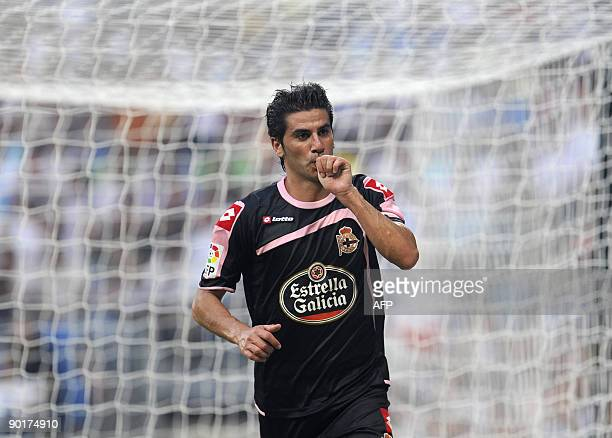 Deportivo's Riki celebrates his goal during their Spanish league football match against Real Madrid at the Santiago Bernabeu Stadium August 29 2009...
