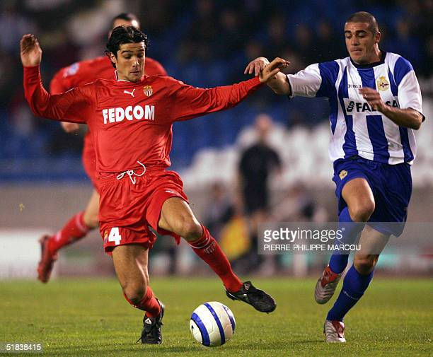 Deportivo's Uruguayan Walter Pandiani vies with Monaco's Francois Modesto during their Group A Champions League football match in La Coruna, 08...