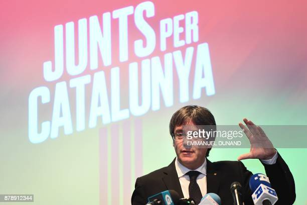 Deposed Catalan leader Carles Puigdemont gives a press conference in Oostkamp near Brugge on November 25 to announce his candidacy for Catalan...