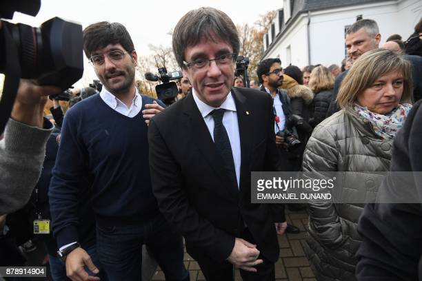 Deposed Catalan leader Carles Puigdemont leaves after posing with his fellow candidates after a press conference in Oostkamp near Brugge on November...