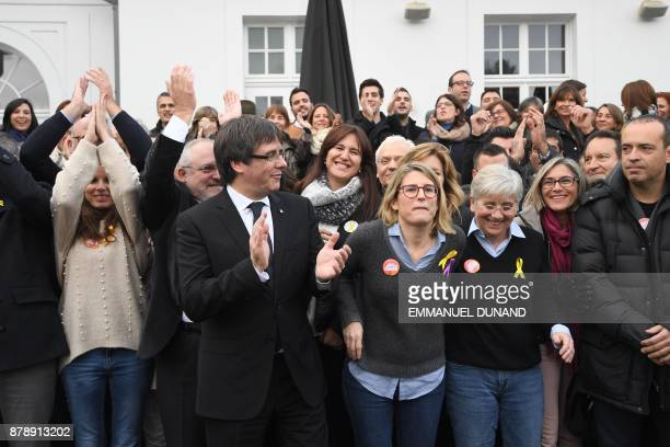 Deposed Catalan leader Carles Puigdemont unites with his fellow candidates after a press conference in Oostkamp near Brugge on November 25 2017 where...