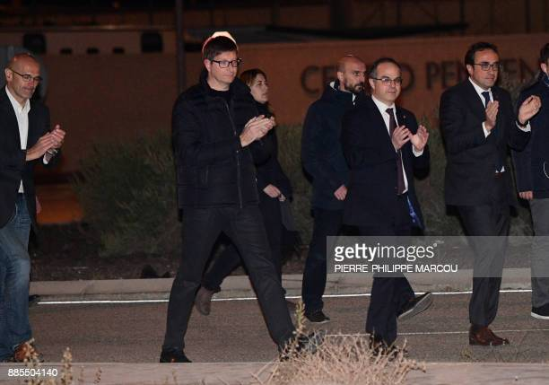 Deposed Catalan regional government foreign relations chief Raul Romeva Deposed Catalan regional government justice chief Carles Mundo Deposed...