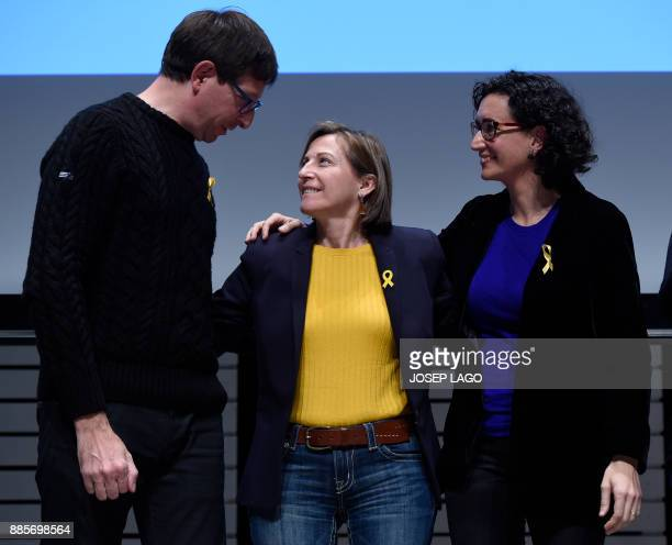 Deposed Catalan regional government justice chief Carles Mundo looks at former president of the Catala parliament Carme Forcadell beside 'Esquerra...