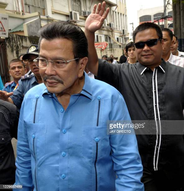 Deposed former president Joseph Estrada arrives at the prosecutor's office accompanied by his son JV Ejercito in San Juan City in the suburbs of...