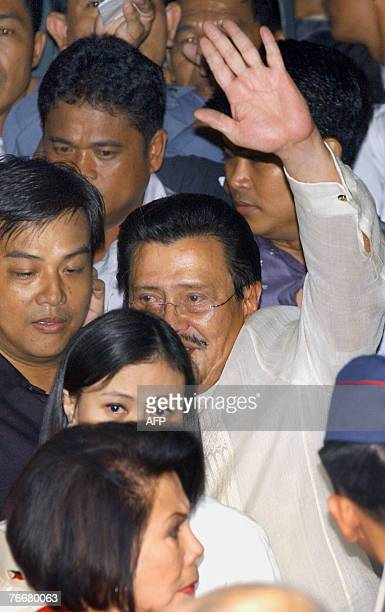 Deposed Philippine president Joseph Estrada with his daughter Jackie Ejercito and wife former senator Luisa Ejercito are accompanied by security from...